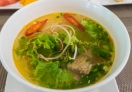 Having delicious Beef Pho Noodle Soup (Pho Bo)