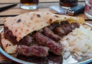 Ćevapi – Bosnian kebabs, small grilled meat sausages made of mix lamb and beef