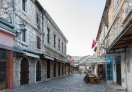 Stores on both side of the narrow cobblestone streets in Mostar