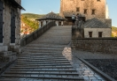 Early in morning, crossing the Old Bridge in Old Town Mostar