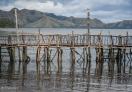 The rustic wooden bridge at Maquinit Hot Spring.