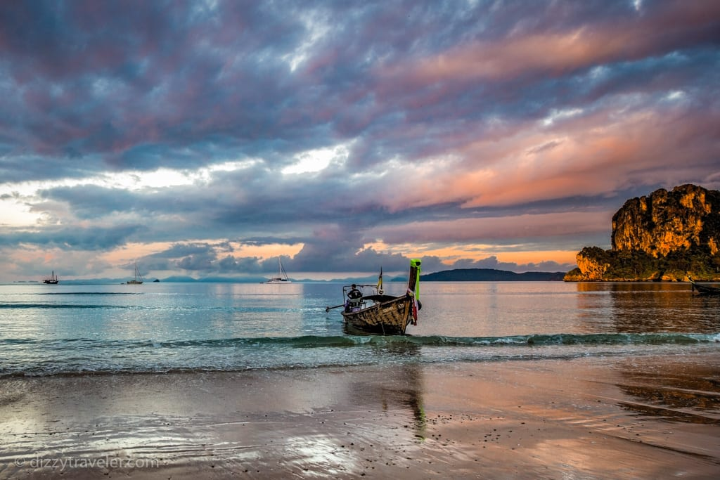 Beautiful early morning view of Railay Beach with a tail boat