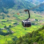 SA PA, VIETNAM - Aug 12, 2019 : The world's longest electric cable car go to Fan Si Pan or Pang Xi Pang mountain peak the highest mountain of Indochina with beautiful Rice field at SA PA, Lao Cai, Vietnam